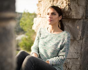 Relaxing woman in thoughtful pose coping with stress and anxiety